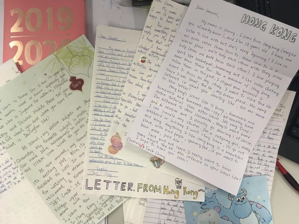 The students in HK have prepared their letters to send to their pen pals in the UK