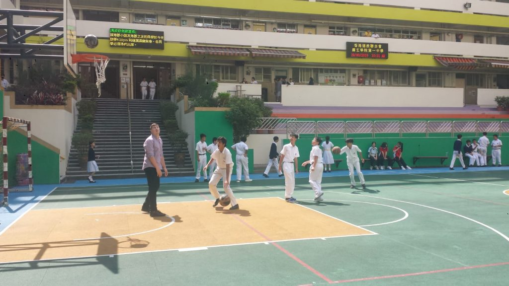 Ashley plays basketball with students during lunchtime