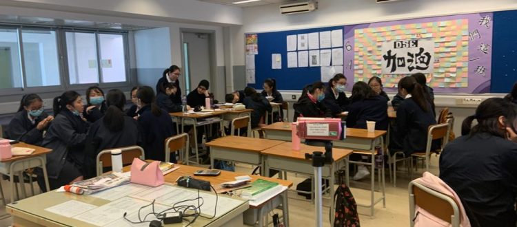 The girls in Hong Kong are writing their letters to send to their pen pals in schools in the UK