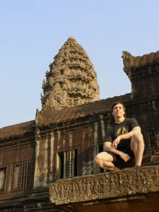 When he's not teaching, John likes to explore other countries in Asia. Here he explores Angkor Wat in Cambodia