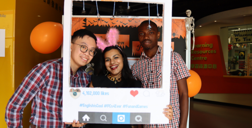 Xavier with his colleagues, Aarohi and Ishmael, at a Halloween event for students