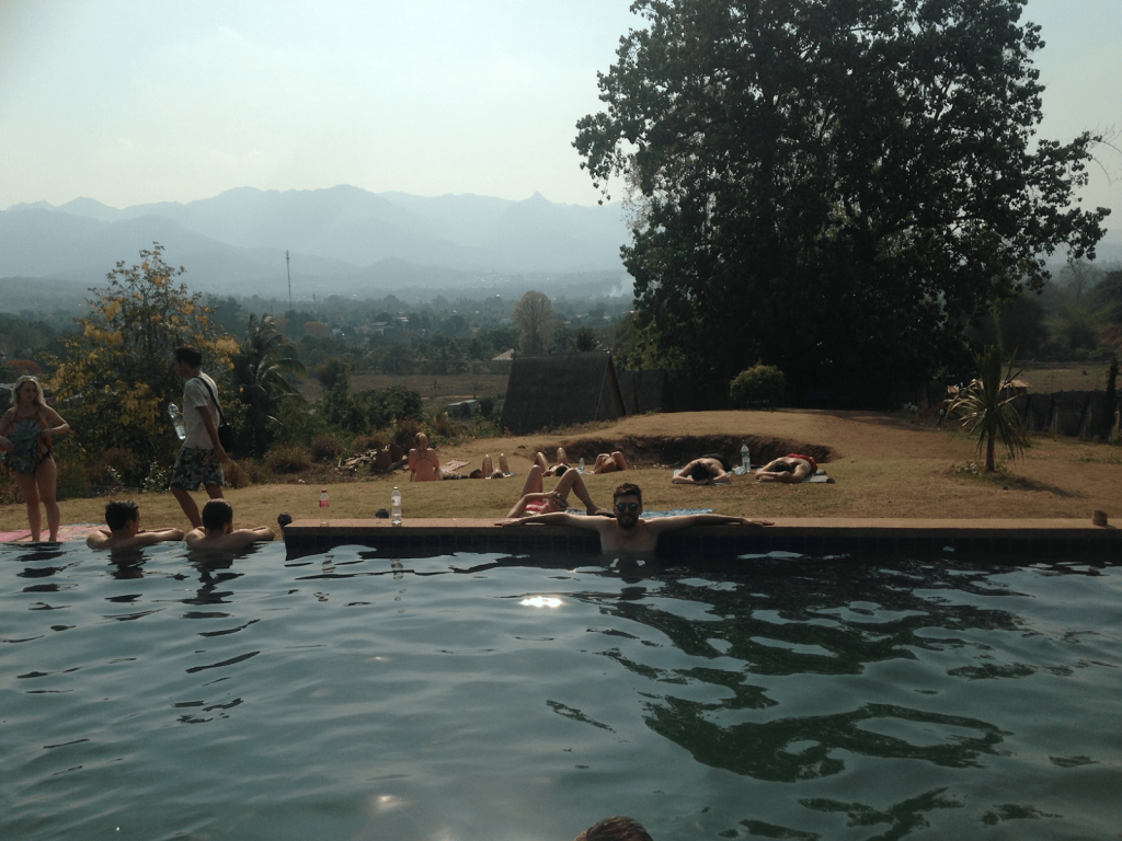 Tim enjoys the pool at his hostel in Pai