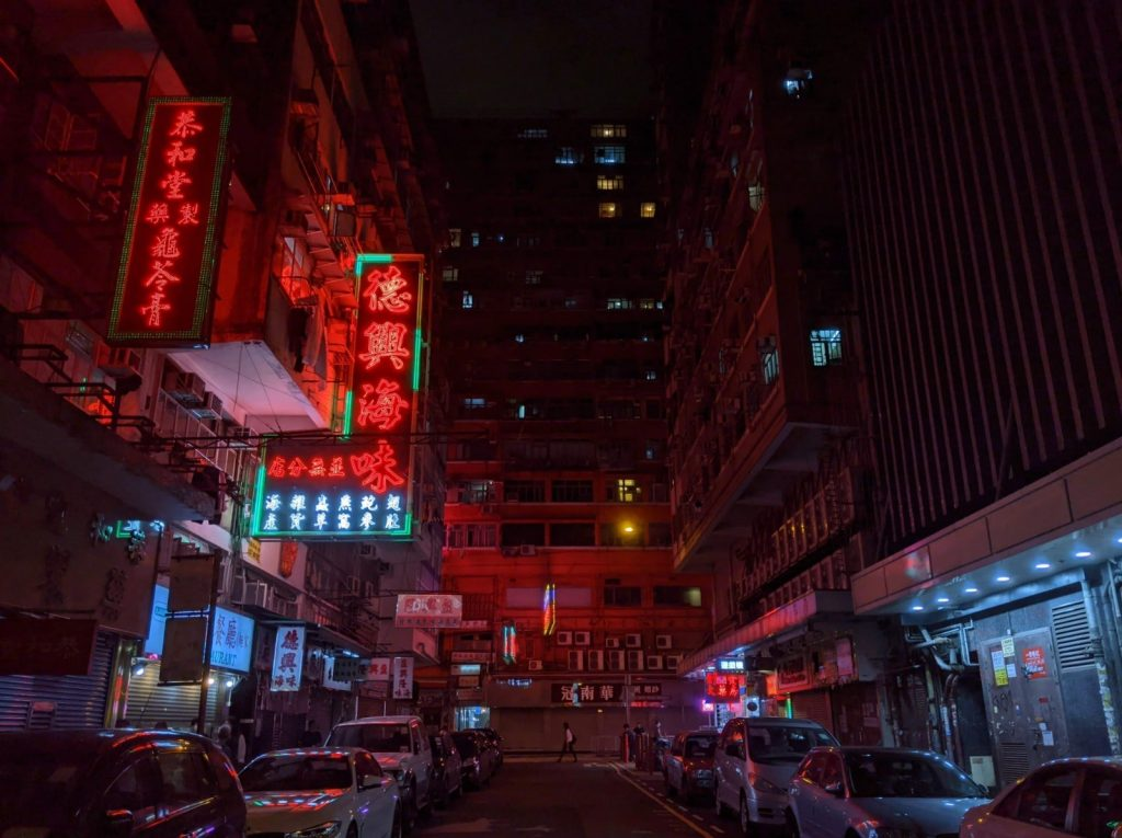 Traditional neon signs light up this Kowloon street at night | Image by Luke Athow