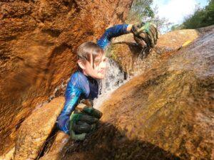 Luke climbs through the Slanted Slit Waterfall