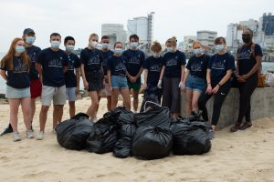 A team of Chatteris tutors with filled rubbish bags after a successful beach clean