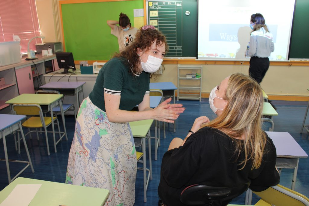 Senior Chatteris Tutor Emmie practices her classroom management skills on Programme Management Team member Carli | Image by Chatteris