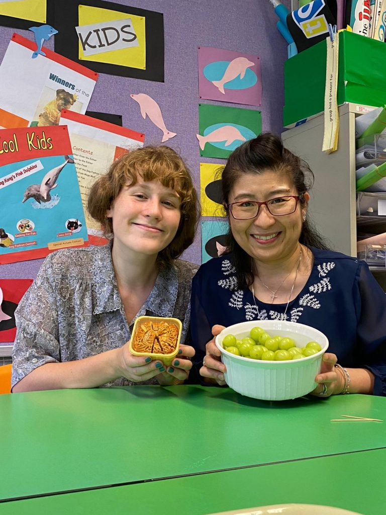 Primary Tutor Grace and her colleague Ms Chan enjoy some traditional Mid-Autumn Festival treats | Image by Grace Baxendine