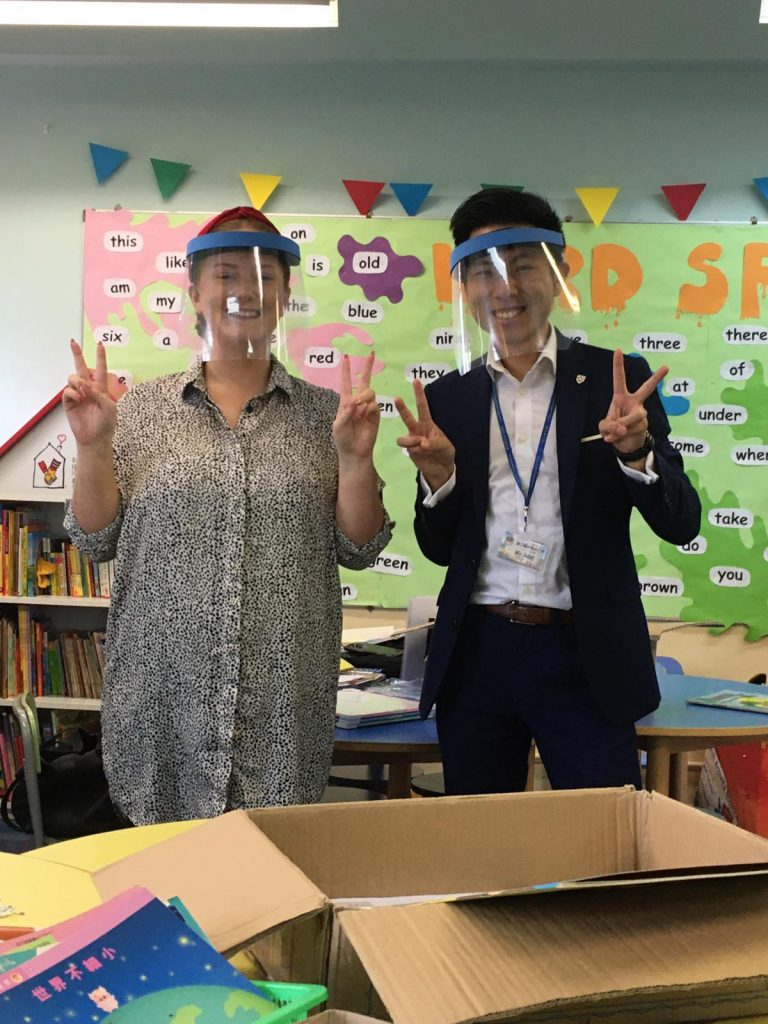 Chatteris Tutors Greta and Jonathan swap their surgical masks for plastic shields in phonics lessons to ensure their students can see their mouth shape for the correct pronunciation | Image by Greta Brown